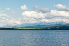 Orava reservoir with mountains in the background. Orava reservoir with High Tatras royalty free stock image