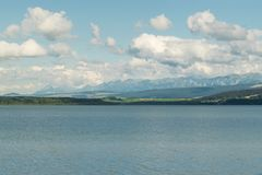 Orava reservoir with mountains in the background. Orava reservoir with High Tatras stock images