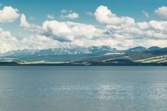 Orava reservoir with mountains in the background. Orava reservoir with High Tatras stock photo