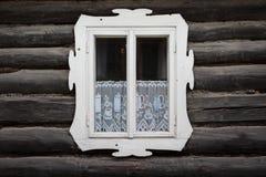Oravsky Biely Potok village in Orava region. Window of a traditional log cabin, Orava region, Slovakia royalty free stock image