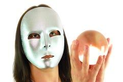 Orb 5. Masked woman holding crstal orb Stock Photos