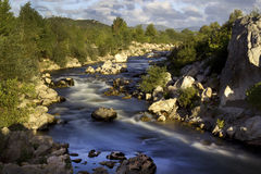 The Orb River. The fast flowing waters of the River Orb in France Royalty Free Stock Image