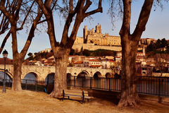 Orb River and Old Town of Beziers, France. A view of the Pont Vieux bridge above the Orb River in Beziers, France, with the Old Town on the right, highlighting royalty free stock photos