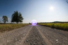Orb in the road - Light Painting. Light Painting an Orb - Ball of Light - Orb in the road Stock Photo
