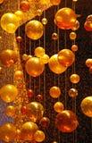 Orbes de oro Imágenes de archivo libres de regalías