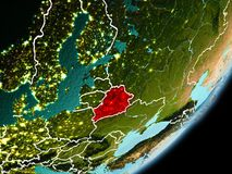 Orbit view of Belarus. Belarus in early morning light highlighted in red on planet Earth with visible border lines and city lights. 3D illustration. Elements of Stock Photo