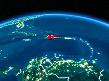 Dominican Republic from space at night. Orbit view of Dominican Republic highlighted in red with visible borderlines and city lights on planet Earth at night. 3D Stock Photo