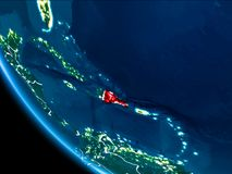 Orbit view of Dominican Republic at night. Map of Dominican Republic in red as seen from space on planet Earth at night with white borderlines and city lights Royalty Free Stock Photos