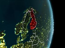 Orbit view of Finland at night. Map of Finland in red as seen from space on planet Earth at night with white borderlines and city lights. 3D illustration Stock Photography