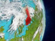 Orbit view of Finland in red. Space view of Finland highlighted in red on planet Earth with atmosphere. 3D illustration. Elements of this image furnished by NASA Stock Image