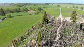 Hill of Crosses. The orbit view of Hill of Crosses a unique monument of history, a famous site of pilgrimage in northern Lithuania, Siauliai stock video footage