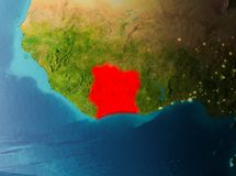 Orbit view of Ivory Coast. Ivory Coast in early morning light highlighted in red on planet Earth. 3D illustration. Elements of this image furnished by NASA Royalty Free Stock Photography