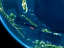 Orbit view of Jamaica at night. Map of Jamaica in red as seen from space on planet Earth at night with white borderlines and city lights. 3D illustration stock photography