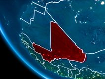 Orbit view of Mali at night. Map of Mali in red as seen from space on planet Earth at night with white borderlines and city lights. 3D illustration. Elements of Royalty Free Stock Image