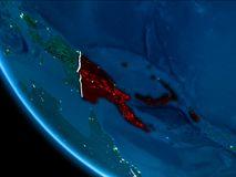 Orbit view of Papua New Guinea at night. Map of Papua New Guinea in red as seen from space on planet Earth at night with white borderlines and city lights. 3D Stock Photos