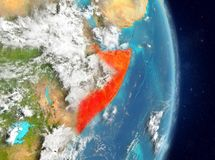 Orbit view of Somalia in red. Space view of Somalia highlighted in red on planet Earth with atmosphere. 3D illustration. Elements of this image furnished by NASA stock image