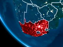 Orbit view of South Africa at night. Map of South Africa in red as seen from space on planet Earth at night with white borderlines and city lights. 3D Royalty Free Stock Photography