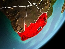 Orbit view of South Africa. South Africa in early morning light highlighted in red on planet Earth with visible border lines and city lights. 3D illustration royalty free stock photography