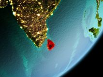Orbit view of Sri Lanka. Sri Lanka in early morning light highlighted in red on planet Earth with visible border lines and city lights. 3D illustration. Elements Stock Photography