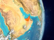Orbit view of United Arab Emirates in red. Space view of United Arab Emirates highlighted in red on planet Earth with atmosphere. 3D illustration. Elements of Royalty Free Stock Photography