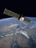 Orbiting Communication Satellite. Communication satellite in geosynchronous orbit stock photos