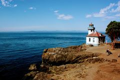 Orcas island shore with lighthouse royalty free stock images
