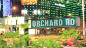Orchard Road Sign with Traffic Time Lapse in Business District