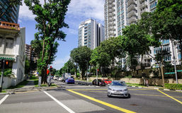 Orchard Road in Singapore. Singapore - Jun 14, 2017. Cars running on Orchard Road with many green trees in Singapore. Orchard Road is the retail and Royalty Free Stock Photos