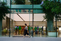 Orchard Road in Singapore. Singapore - Jun 14, 2017. People visit Apple Store on Orchard Road in Singapore. Orchard Road is the retail and entertainment hub of Stock Image