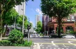 Orchard Road in Singapore. Singapore - Jun 14, 2017. View of Orchard Road with many green trees in Singapore. Orchard Road is the retail and entertainment hub of Stock Photo