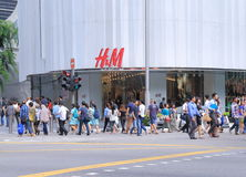 Orchard Road Singapore. People walk across Orchard road H&M store in Singapore Stock Photos