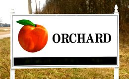 Orchard Sign With Peach On It Royalty Free Stock Photography
