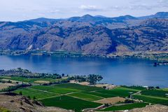 Orchards, vineyards, lake and mountains. Royalty Free Stock Image