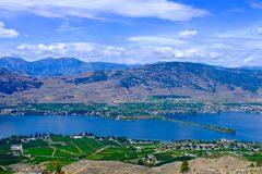 Orchards, vineyards, lake and mountains. Stock Photos