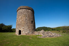 Orchardton Castle, Dumfries and Galloway, Scotland. Is a ruined tower house built by the Cairns family in the mid 15th century with a circular design unique in Royalty Free Stock Photo