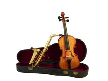 Orchestra. A violin and a saxophone standing in a case Stock Image