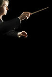 Orchestra concert conductor. Orchestra conductor music concert conducting isolated on black Stock Photos