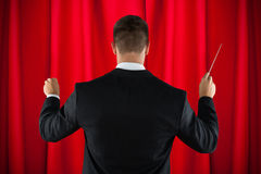 Orchestra Conductor Directing With His Baton Stock Photos