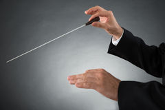 Orchestra Conductor Holding Baton. Close-up Of Male Orchestra Conductor Hands Holding Baton Royalty Free Stock Photography