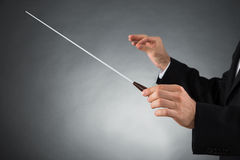 Orchestra Conductor Holding Baton. Close-up Of Male Orchestra Conductor Hands Holding Baton Stock Photos
