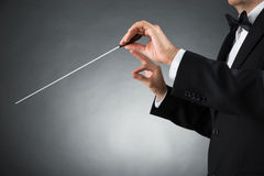 Orchestra Conductor Holding Baton. Close-up Of Male Orchestra Conductor Hands Holding Baton Royalty Free Stock Photo