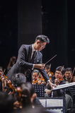 Orchestra Conductor. A conductor leading an orchestra Royalty Free Stock Photos