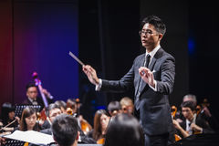 Orchestra Conductor. A conductor leading an orchestra Stock Images