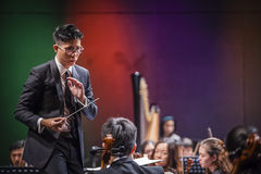Orchestra Conductor. A conductor leading an orchestra Stock Photo