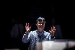 Orchestra Conductor. A conductor leading an orchestra Royalty Free Stock Photography