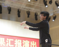 The orchestra conductor of songbai school Stock Photo