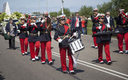 Orchestra drummers on Bloemencorso parade. Sassenheim, Netherlands – May 03, 2014: Orchestra drummers follows the route of the traditionl flowers parade ' royalty free stock photo