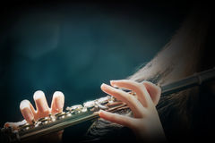 Orchestra instruments flute. Flute playing flutist musician hands Royalty Free Stock Photos