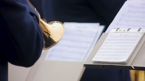 Orchestra musician reading notes and skillfully performing part on trumpet, show. Stock footage stock video