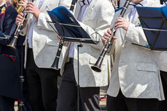 Orchestra musicians playing clarinets during city music fest Stock Photos